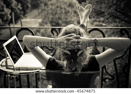 young woman relaxing on the balkony - stock photo
