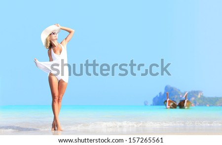 Young woman relaxing on the beach at exotic resort on Phi Phi island in Thailand
