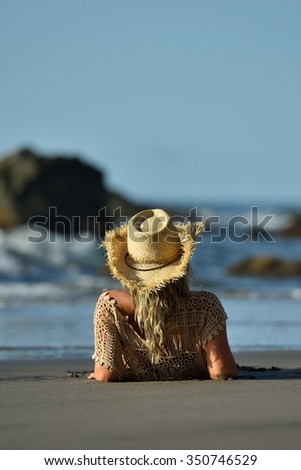 young woman relaxing on the beach in summer day - stock photo