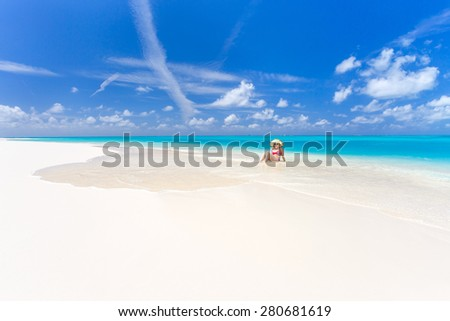 Young woman relaxing on the caribbean beach in Cuba - stock photo
