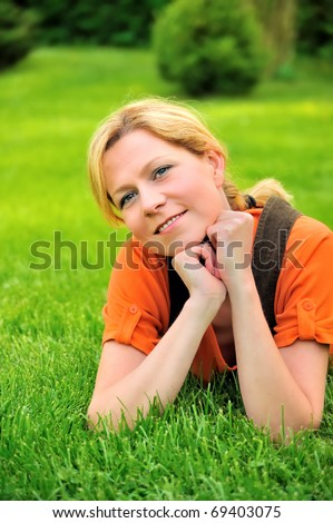 Young woman relaxing on the grass - stock photo