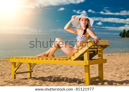 Young woman relaxing on the sea beach - stock photo