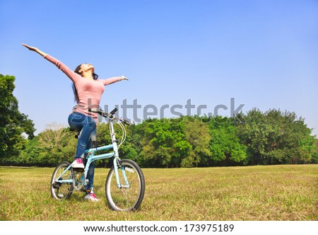 Young woman relaxing while sitting on a bike. - stock photo