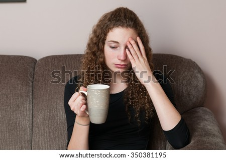 young woman relaxing with a cup of tea after a hard day