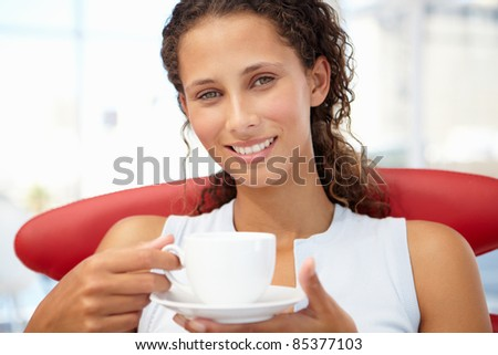 Young woman relaxing with cup of tea - stock photo