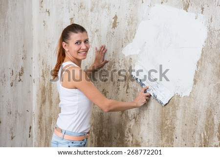 Young Woman repair her apartment - stock photo