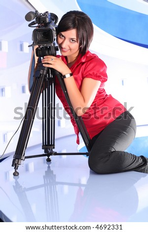 Young woman reporter posing like a photo model in TV studio - stock photo