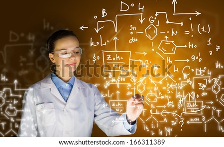 Young woman researcher in medical uniform drawing chemistry formulas - stock photo