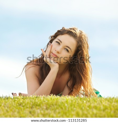 young woman rest on the green grass