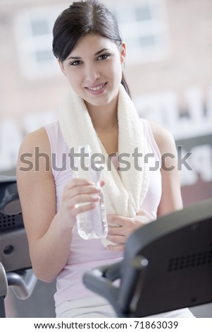 Young woman resting at gym - stock photo