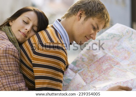 Young Woman Resting Head on Boyfriend - stock photo