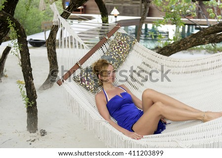 Young woman resting in a hammock.