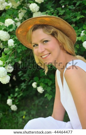 Young woman resting in garden - stock photo