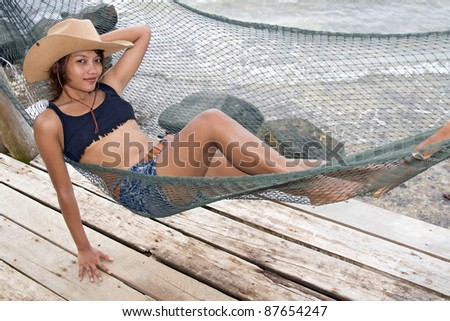 Young woman resting on a hammock - stock photo
