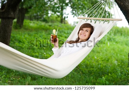 Young woman resting on hammock - stock photo