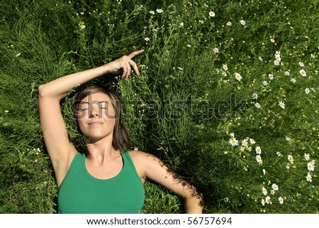 Young Woman resting on meadow. Summer relax. - stock photo