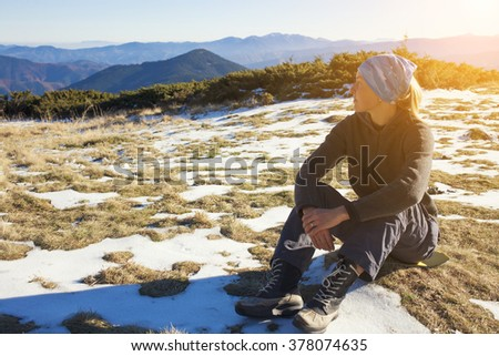 Young woman resting on nature alone