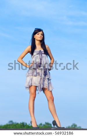 Young woman resting on residential building roof