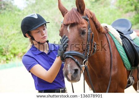 young woman rider and horse are friends - stock photo