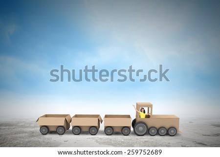 Young woman riding carton train. Women in business - stock photo