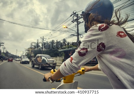 Young woman riding motorcycle in town. Adventure and vacations concept. - stock photo