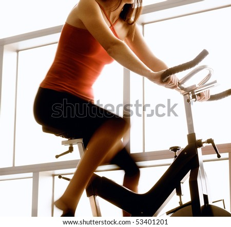 young woman riding on a bicycle - stock photo