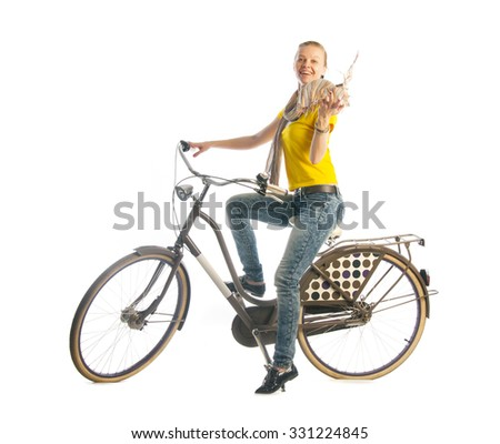 Young woman riding on bicycle isolated on white background