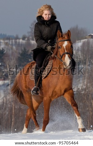 Young woman riding Russian Don horse breed