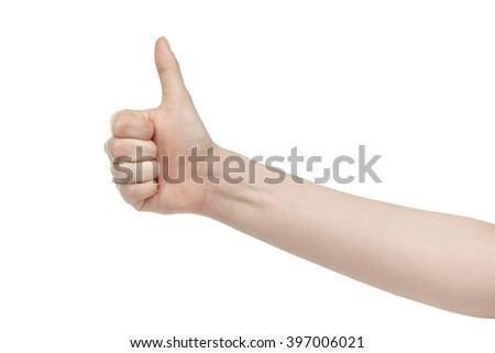 young woman right hand shows thumb up gesture, isolated on white - stock photo