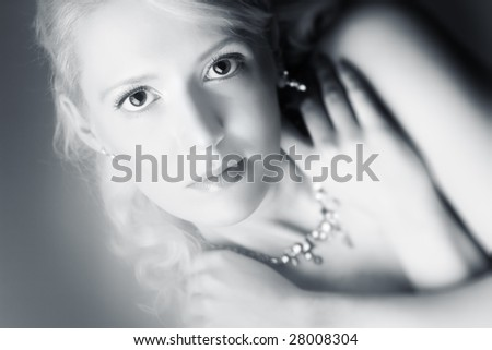Young woman romantic portrait. Soft silver tint. - stock photo