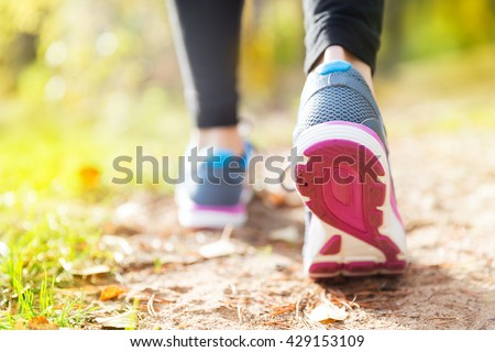 Young woman run in autumn the forest in sunset lights - stock photo