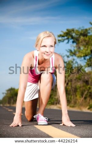Young woman runner at the start. Sport collection.