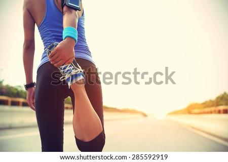 young woman runner warm up outdoor - stock photo