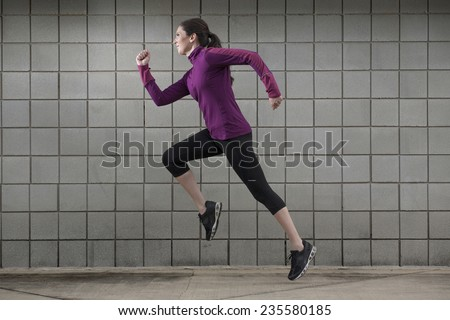 Young Woman Running - stock photo