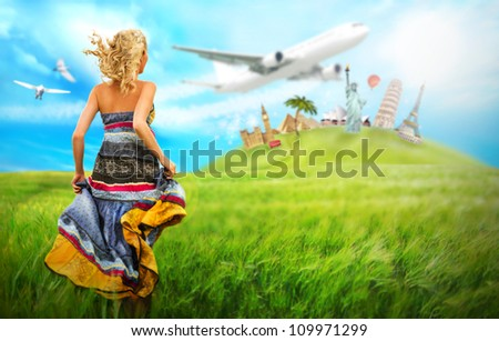 Young woman running across field to hill with world's famous buildings. Traveling dream concept - stock photo