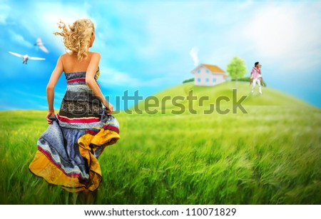 Young woman running across field to house and family of her dream. Dreams come true with mortgage concept - stock photo