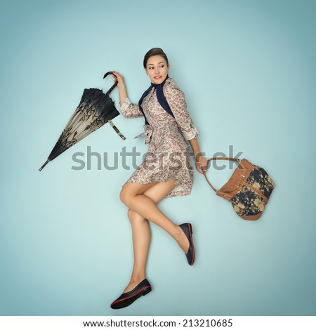 Young woman running hurry up holding umbrella and bag in the autumn rain. Image filtered. - stock photo