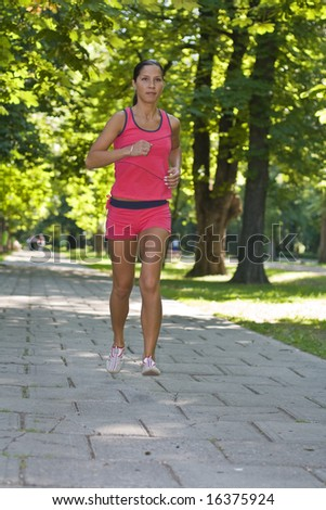 Young woman running in a park.
