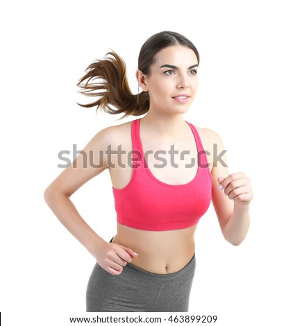 Young woman running isolated on white