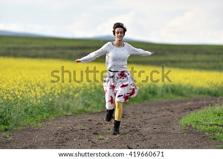 Young woman running on a countryside road. Freedom concept - stock photo