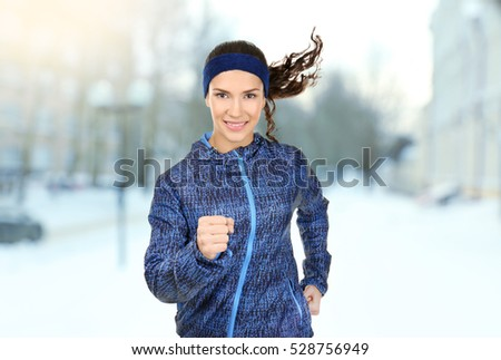 Young woman running on city street. Sport and healthy lifestyle concept.