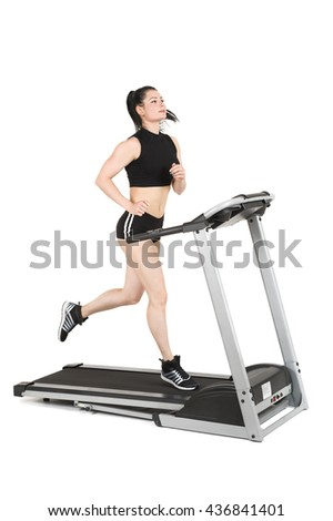 young woman running on treadmill - stock photo