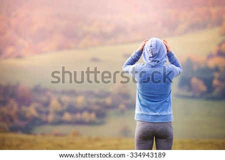 Young woman running outside in autumn nature - stock photo