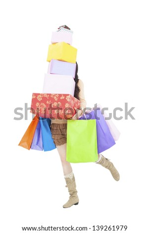 young woman running with gift box and shopping bags