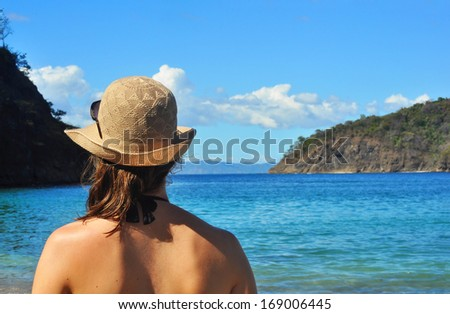Young woman's back, looking at the sea at the beach in Costa Rica - stock photo