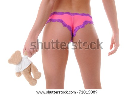 Young Woman's Backside in Lingerie Holding a Teddy Bear - stock photo