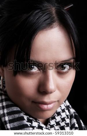 Young woman's face staring at the camera