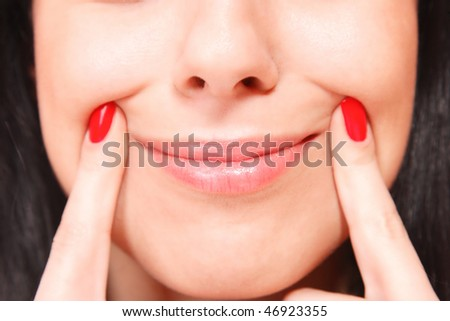 Young woman's glossy pink lips close up