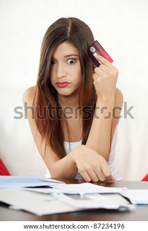 Young woman's paying bills. In home. - stock photo