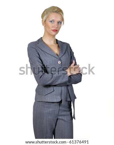 Young woman's portrait in businesswomen dress  keeping crossed hands.